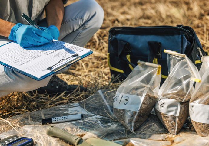 Soil Test. Female agronomist taking notes in the field. Environmental protection, organic soil certification, research