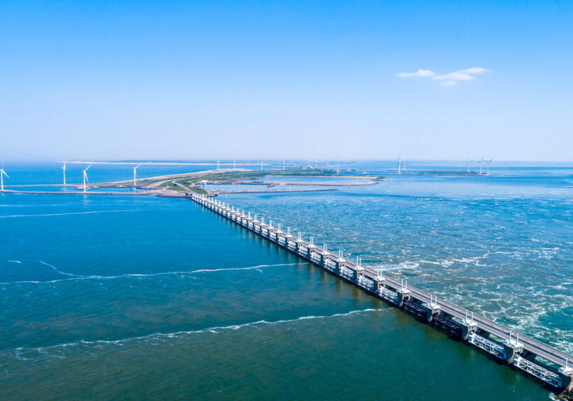Oosterschelde flood barrier with windmills in the Netherlands at the Northern Sea taken from above with a drone